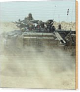 An Amphibious Assault Vehicle Kicks Wood Print