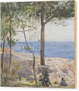 An Artist Painting By The Sea Wood Print