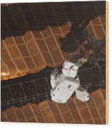 An Astronaut Anchored To A Foot Wood Print