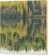 An Autumn View Of A Cabin Reflected Wood Print