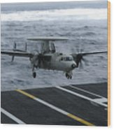 An E-2c Hawkeye Lands Aboard Wood Print by Stocktrek Images