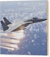 An F-15 Eagle Releases Flares Wood Print