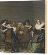 An Interior With Musicians Seated Around A Table  Wood Print
