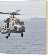 An Mh-60r Seahawk Helicopter In Flight Wood Print