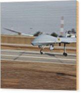 An Mq-1c Sky Warrior Uav Lands At Camp Wood Print by Stocktrek Images