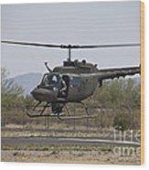 An Oh-58 Kiowa Helicopter Of The U.s Wood Print