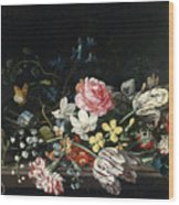 An Overturned Vase Of Flowers Resting On A Ledge Wood Print