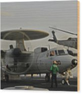 An Sh-60f Sea Hawk Helicopter Lifts Off Wood Print
