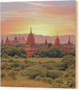 Ancient Pagodas In The Countryside From Bagan In Myanmar At Suns Wood Print