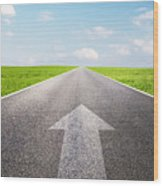 Arrow Sign Pointing Forward On Long Empty Straight Road Wood Print
