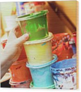 Artist Reaching For A Liquid Paint Container. Wood Print