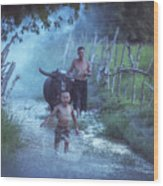 Asian Boy Playing Water With Dad And Buffalo Wood Print