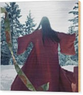 Asian Woman In Red Kimono Dancing In The Snow Spinning Around To Wood Print