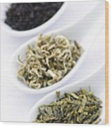 Assortment Of Dry Tea Leaves In Spoons Wood Print