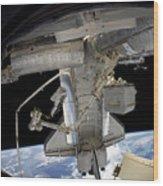 Astronaut Participates In A Spacewalk Wood Print