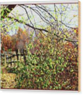 Autumn Leaves Against A Fence Wood Print
