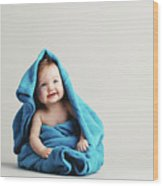 Baby Girl Covered With A Blue Warm Blanket Wood Print