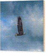 Bald Eagle Flying Across A Cloudy Sky Wood Print