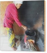 Balinese Lady Roasting Coffee Over The Fire Wood Print