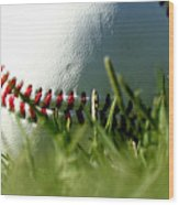 Baseball In Grass Wood Print