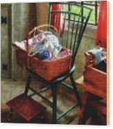 Basket Of Cloth And Yarn On Chair Wood Print