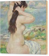 Bather Arranging Her Hair Wood Print by Pierre Auguste Renoir