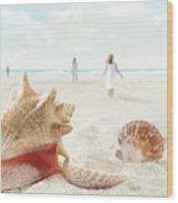 Beach Scene With People Walking And Seashells Wood Print
