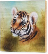 Beautiful Airbrush Painting Of An Adorable Baby Tiger Head Looking Out From A Green Grass Surroundin Wood Print