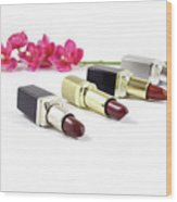 Beauty And Esthetics Care. Lipsticks And Flowers Wood Print