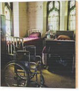 Beds And Wheelchair In Abandoned Church Wood Print
