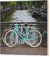 Bicycle Parked At The Bridge In Amsterdam. Netherlands. Europe Wood Print