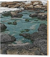 Black Rocks On Blue Water Wood Print