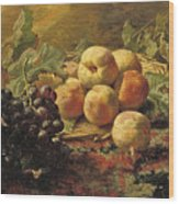 Blue Grapes And Peaches In A Wicker Basket Wood Print