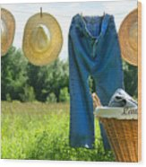 Blue Jeans And Straw Hats On Clothesline Wood Print
