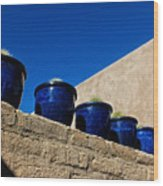 Blue Pottery On Wall Wood Print
