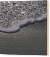 Blurred Motion Of A Wave On The Shore Wood Print