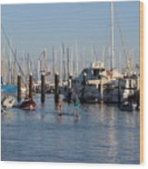 Boat Aims At Paddleboarders Wood Print