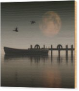 Boat On A Lake With Geese Flying Over Wood Print