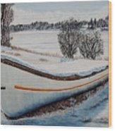 Boat Under Snow Wood Print