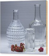 Bottles And Red Flowers  Wood Print