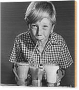 Boy Drinking Three Shakes At Once Wood Print