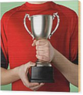 Boy Holding Trophy Wood Print by Jeffrey Coolidge