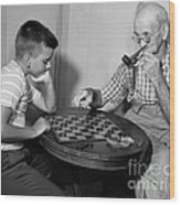 Boy Playing Checkers With Grandfather Wood Print