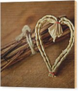 Braided Wicker Heart On Small Bundled Wood Wood Print