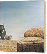Bread And Wheat Cereal Crops.traktor On The Background Wood Print