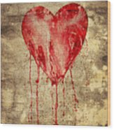 Broken And Bleeding Heart On The Wall Wood Print