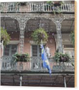 Bubbles Blow From An Ornate Balcony In New Orleans At Mardi Gras Wood Print