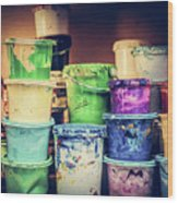 Buckets Of Liquid Paint Standing In A Workshop. Wood Print