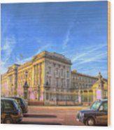 Buckingham Palace And London Taxis Wood Print