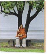 Buddhist Monk Sits Under Tree Wood Print